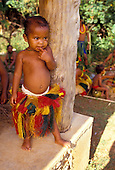 Little boy standing next to a post, Yap Micronesia