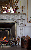 Neo-classical figures support the mantelpiece of the Italian marble fireplace in the drawing room