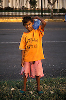 Poor Nicaraguan boy wearing tattered clothing in downtown Managua, Nicaragua