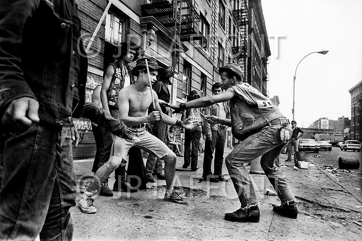 025 Savage Skulls playing fights on sidewalk LAF37334 02.jpg