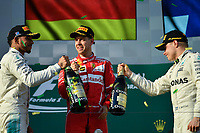 March 26, 2017: Lewis Hamilton (GBR) #44 from the Mercedes AMG Petronas team, Sebastian Vettel (DEU) #5 from the Scuderia Ferrari team and Valtteri Bottas (FIN) #77 from the Mercedes AMG Petronas team congratulate each other on the podium at the 2017 Australian Formula One Grand Prix at Albert Park, Melbourne, Australia. Photo Sydney Low