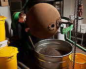 Hallot Parson, of Escazu chocolates, dispenses a batch of fresh roasted chocolate beans from an antique roaster in the back of their storefront and production warehouse at 936 N. Blount St. in Raleigh, NC, November 29, 2011. ..Photo by D.L. Anderson
