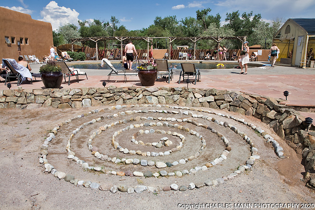 Visitors relax by the big pool at the Ojo Caliente Mineral Springs Resort and Spa near the village of Ojo Caliente, in northern New Mexico
