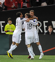Los Angeles Galaxy Mike Magee (28) celebrates with team mates David Beckham (23) and Juninho (19) his goal in the 12th minute of the game.  DC United tied Los Angeles Galaxy 1-1, at RFK Stadium, Saturday April 9, 2011.