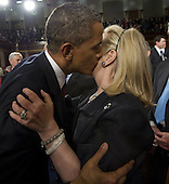 United States President Barack Obama greets United States Secretary of State Hillary Clinton following his State of the Union address in front of a joint session of Congress on Tuesday, January 24, 2012 at the US Capitol in Washington, DC.  .Credit: Saul Loeb / Pool via CNP