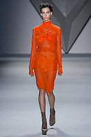Ruby Aldridge walks runway in a tangerine silk chiffon crisscross appliqué long sleeve dress with stand melton collar and tangerine silk organza zip-front peplum tangerine silk chiffon bermuda short, from the Vera Wang Fall 2012 Vis-a-gris collection, during Mercedes-Benz Fashion Week Fall 2012 in New York.