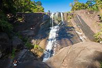 Man on the rocks of Langkawi Telaga Tujuh (Seven Wells) waterfalls, Langkawi, Malaysia