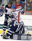 Phil DeSimone (UNH - 39), Michael Scheu (Lowell - 20), Matt DiGirolamo (UNH - 30) - The visiting University of New Hampshire Wildcats defeated the University of Massachusetts-Lowell River Hawks 3-0 on Thursday, December 2, 2010, at Tsongas Arena in Lowell, Massachusetts.