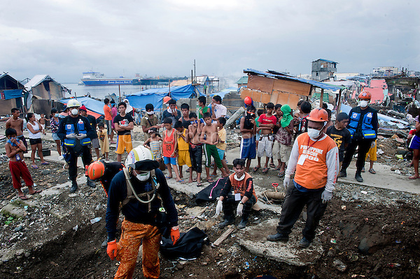 Magali Corouge / Documentography<br />Nov-Dec 2013, Tacloban, Leyte, Philippines.<br /><br />Bodies are still being pulled from under the debris in Tacloban 20 days after the typhoon Haiyan hits the Philippines.