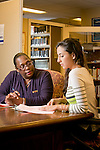 Iris Turrentine, a human resources associate in Perkins Library assists freshman Karla Beltran with her work/study paperwork