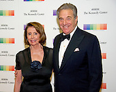 United States House Minority Leader Nancy Pelosi (Democrat of California) and her husband, Paul, arrive for the formal Artist's Dinner honoring the recipients of the 39th Annual Kennedy Center Honors hosted by United States Secretary of State John F. Kerry at the U.S. Department of State in Washington, D.C. on Saturday, December 3, 2016. The 2016 honorees are: Argentine pianist Martha Argerich; rock band the Eagles; screen and stage actor Al Pacino; gospel and blues singer Mavis Staples; and musician James Taylor.<br /> Credit: Ron Sachs / Pool via CNP