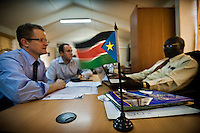 Officials from the Joint Donor Office in a meeting with an official from the government of South Sudan. Western countries established the Joint Donor Office in Juba as a cooperation framework used to oversea the spending of millions of dollars that has been pumped into South Sudan to aid with its recovery. Central Equatoria, South Sudan.