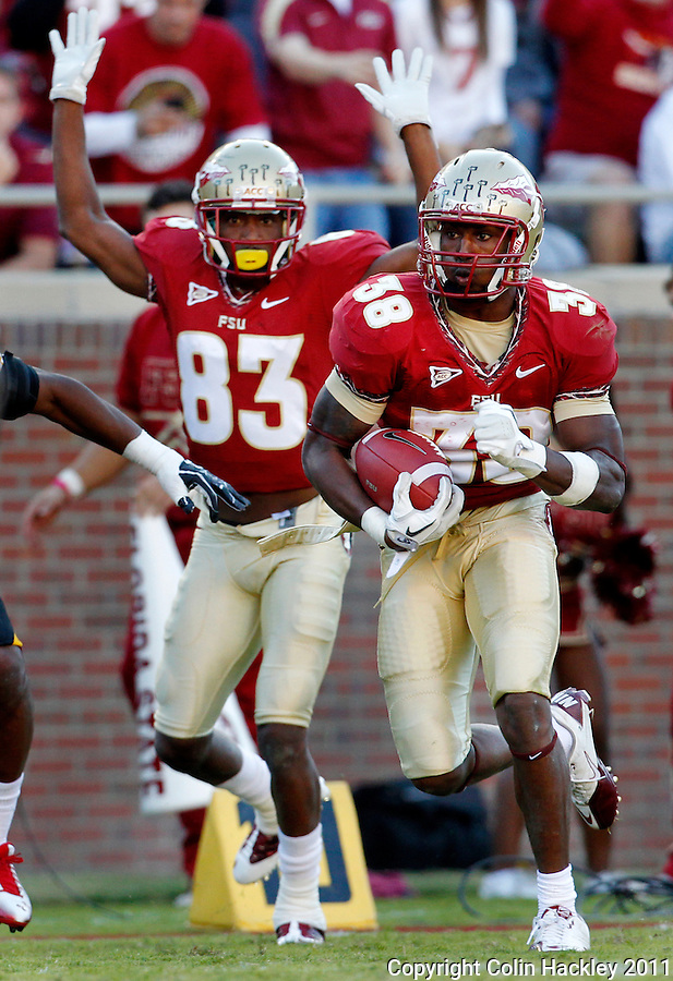 TALLAHASSEE, FL 10/22/11-FSU-MARY102211 CH-Florida State's Jermaine Thomas heads for the end zone as Bert Reed signals the touchdown against Maryland during second half action Saturday at Doak Campbell Stadium in Tallahassee. The Seminoles beat the Terrapins 41-16..COLIN HACKLEY PHOTO