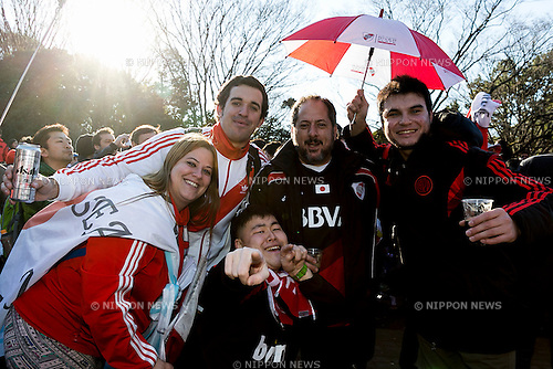 River Plate fans pose for a photograph in Yoyogi Park on December 19, 2015, Tokyo, Japan. Thousands of Argentine soccer fans came to Tokyo to support their team on the final match (FC Barcelona vs River Plate) in the FIFA Club World Cup Japan 2015 to be held on December 20 in Yokohama. (Photo by Rodrigo Reyes Marin/AFLO)