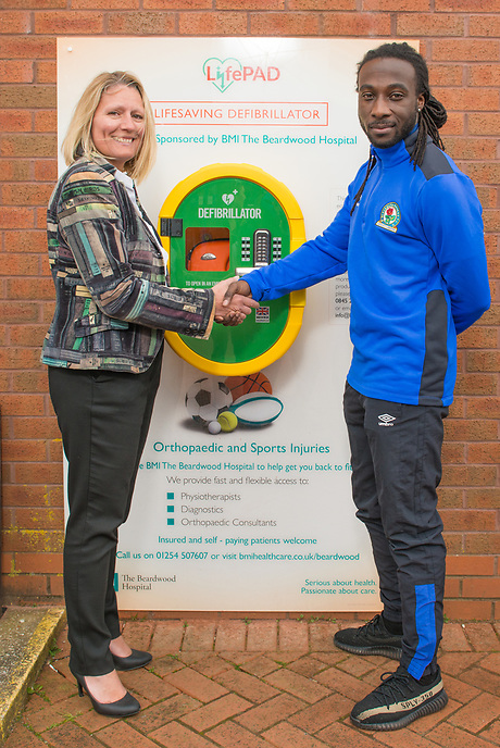 Samantha Sheehan, Executive Director of BMI Healthcare's Beardwood Hospital (left) at a ceremony with Blackburn Rovers FC player Marvin Emnes marking the sponsorship of a Defibrillator unit by BMI Healthcare at Ewood Park, home of Blackburn Rovers FC.