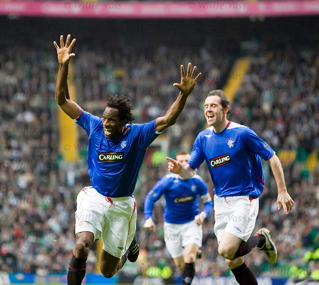 Ugo Ehiogu scores for Rangers in the no 12 top at Celtic Park and is chased by a young Davie Weir