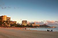 Sunset at Waikiki Beach with Diamond Head Crater in the distance, Honolulu, O'ahu.