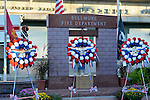 Bellmore, New York, USA. September 11, 2015. At Bellmore Memorial Ceremony for 3 Bellmore volunteer firefighters and 7 residents who died due to 9/11 terrorist attack at NYC Twin Towers, a wreath is placed for each firefighter lost. Bellmore volunteer firefighters Lt. Kevin Prior and F.F. Adam Rand died on 9/11/2001, and F.F. Sean McCarthy died in 2008 due to illness related to working at scene of attack.