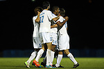 06 December 2014: North Carolina's Omar Holness (JAM) (14) celebrates his goal with Alan Winn (5), Walker Hume (37) and Nick Williams (right). The University of California Los Angeles Bruins hosted the University of North Carolina Tar Heels at Drake Stadium in Los Angeles, California in a 2014 NCAA Division I Men's Soccer Tournament Quarterfinal round match. The game ended in a 3-3 tie after two overtimes. UCLA advanced to the next round by winning the penalty kick shootout 7-6.