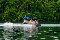 A pontoon boat on Philpott Lake, near Roanoke, Virginia USA.