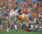 Tennessee tight end Luke Stocker (88) is tackled by Ole Miss safety Fon Ingram (35) and Ole Miss linebacker Allen Walker (9) in a college football game at Neyland Stadium in Knoxville, Tenn. on Saturday, November 13, 2010. Tennessee won 52-14.