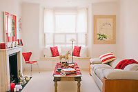 The colour scheme of this London living room has been transformed into a cheerful red and white in preparation for Christmas