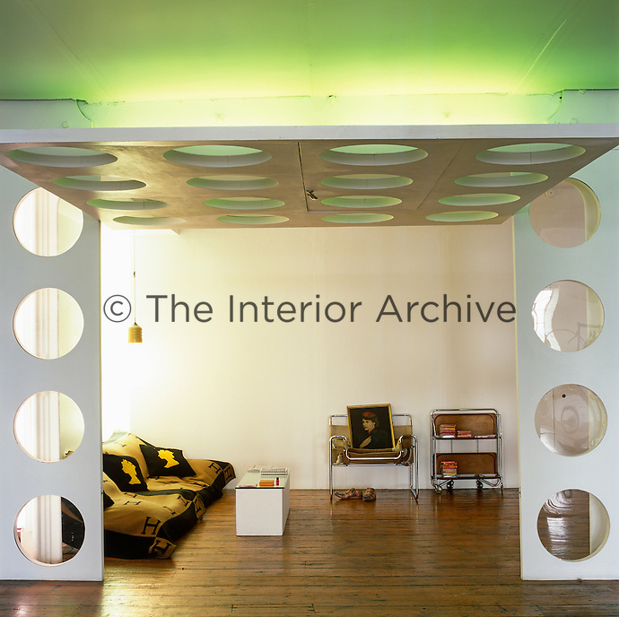 Major structural work was forbidden in the warehouse so the space has been divided into space-age cells with white porthole panels that open like garage doors
