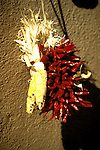New Mexico: Santa Fe, dried chile peppers, Christmas ristras,  Photo: nmarts101.Photo copyright Lee Foster, www.fostertravel.com, 510/549-2202, lee@fostertravel.com