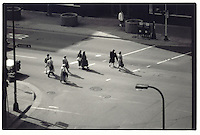 Office workers cross the street in Downtown Minneapolis shortly after 5:00