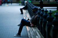 A man rests on a bench at central park in New York.  06/05/2015. Eduardo MunozAlvarez/VIEWpress