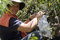 Rosa Maria Roman-Cuesta collects an orchid specimen for Cusco herbarium