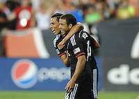Washington D.C. - July 30, 2014: Nick DeLeon (14) of D.C. United celebrates his score with teammate Luis Silva.  D.C. United defeated the Toronto FC 3-1 during a Major League Soccer match for the 2014 season at RFK Stadium.