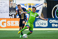Brian Carroll (7) of the Philadelphia Union and Mauro Rosales (10) of the Seattle Sounders. The Philadelphia Union and the Seattle Sounders played to a 2-2 tie during a Major League Soccer (MLS) match at PPL Park in Chester, PA, on May 4, 2013.