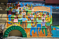 Mural promoting peace on the side of a church in Harlem in New York on Saturday, August 24, 2013. (© Richard B. Levine)