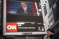 Passer-by gather in Times Square in New York on Monday, January 21, 2013 to watch the inauguration of Barack Obama for his second term as the 44th president. (© Richard B. Levine)