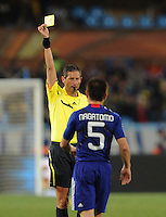 Belgium Referee Frank De Bleeckere issues a yellow card to Japan's Yuto Nagatomo. Japan and Paraguay played in the second round of the 2010 FIFA World Cup in Loftus Versfeld Stadium, in Pretoria, South Africa, June 29th. After regulation and extra time ended 0-0, Paraguay advanced to the quarterfinals, 5-3, in a penalty-kick shootout.