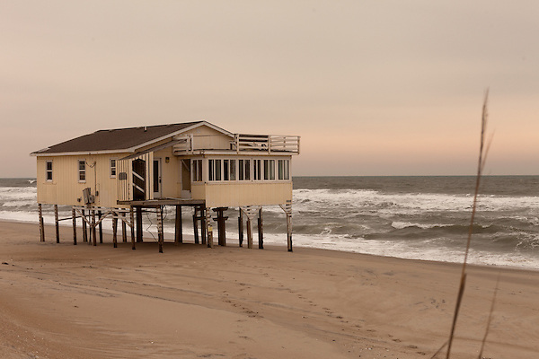 February 25, 2013. Nag's Head, North Carolina. Many houses along the shore in the Outer Banks have been abandoned as the beach erodes. Residences that were formerly rows back from the beach have become beachfront as older houses collapse into the sea.. Tracing the path of Hurricane Sandy, which wrecked havoc on the northeastern seaboard from October 25-31, 2012. The storm caused flooding and caused an estimated 60 billion dollars worth of damage to affected areas.