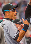 7 April 2016: Miami Marlins outfielder Ichiro Suzuki stands ready in the dugout prior to the Washington Nationals Home Opening Game at Nationals Park in Washington, DC. The Marlins defeated the Nationals 6-4 in their first meeting of the 2016 MLB season. Mandatory Credit: Ed Wolfstein Photo *** RAW (NEF) Image File Available ***