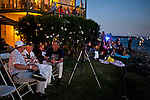 Barron Hilton, center, chats with Chip Arnett, left, and Peter Ottesen, right, while waiting  for his fireworks show at the Venice Island Duck Club in the Delta, July 4, 2010.