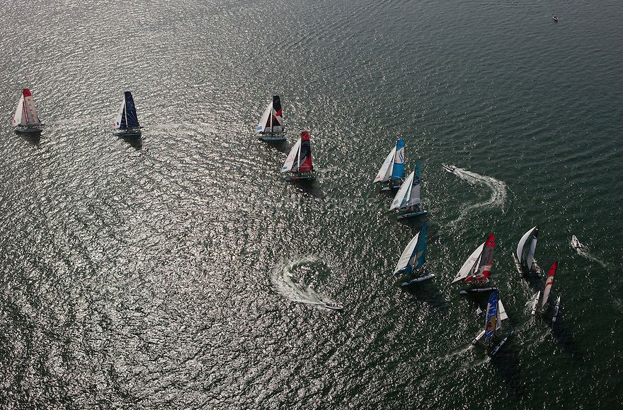 Extreme Sailing Series 2011. Leg 1. Muscat. Oman.Day 5 of racing.   Picture showing Luna Rossa leading the fleet during the first race of day 5.