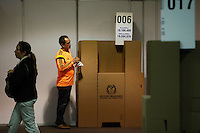 BOGOTA, Colombia. 13th June 2014. People cast their vote during the runoff for presidential elections in Bogota, Colombia. Photo by Eduardo Munoz Alvarez/VIEWpress