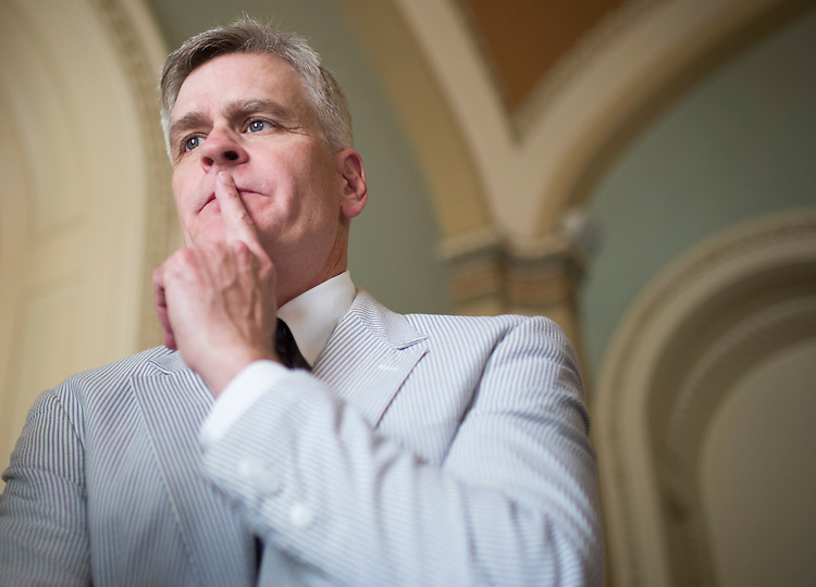 UNITED STATES - JUNE 11: Sen. Bill Cassidy, R-La., speaks with reporters in the Ohio Clock Corridor after posing with other Senators for the Official National Seersucker Day Photograph in celebration of National Seersucker Day on Thursday, June 11, 2015. Continuing the tradition introduced by Sen. Trent Lott (R-MS) in 1996, Dr. Cassidy reintroduced National Seersucker Day in the U.S. House of Representatives in 2014 and is continuing the tradition in the U.S. Senate. (Photo By Bill Clark/CQ Roll Call)