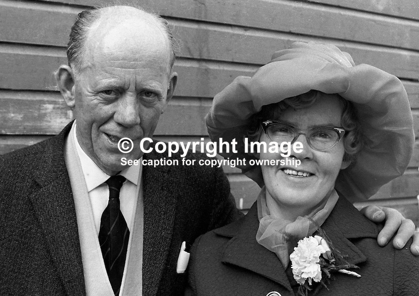 Mr John McGuigan, and wife, Mrs Mary McGuigan, 19 Jamaica Street, Belfast, at a family wedding. 197208260446d.<br /> <br /> Copyright Image from Victor Patterson, 54 Dorchester Park, Belfast, UK, BT9 6RJ<br /> <br /> t1: +44 28 9066 1296 (from Rep of Ireland 048 9066 1296)<br /> t2: +44 28 9002 2446 (from Rep of Ireland 048 9002 2446)<br /> m: +44 7802 353836<br /> <br /> e1: victorpatterson@me.com<br /> e2: victorpatterson@gmail.com<br /> <br /> The use of my copyright images is subject to my Terms &amp; Conditions.<br /> <br /> It is IMPORTANT that you familiarise yourself with them. They are available on my website at www.victorpatterson.com.<br /> <br /> None of my copyright images may be used on a website unless they are visibly watermarked, i.e. &copy; Victor Patterson within the body of the visible image. Metadata denoting my copyright must NOT be deleted. <br /> <br /> Web use is extra at currently recommended NUJ rates.
