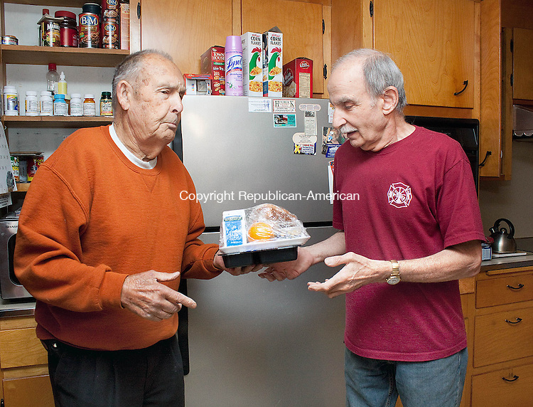 WOLCOTT CT-MAY 09 2013- 0050913DA14- George Lane, a driver for Meals on Wheels, left, deliver a few meals to Harry Sasso of Wolcott on Thursday..Darlene Douty Republican American