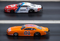 Oct 29, 2016; Las Vegas, NV, USA; NHRA pro stock driver Bo Butner (near) and his Dukes of Hazzard themed car races alongside Shane Gray during qualifying for the Toyota Nationals at The Strip at Las Vegas Motor Speedway. Mandatory Credit: Mark J. Rebilas-USA TODAY Sports