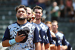 02 June 2016: Nova Southeastern's Brandon Gomez (24) and his teammates line up for the playing of the national anthem. The Nova Southeastern University Sharks played the Cal Poly Pomona Broncos in Game 11 of the 2016 NCAA Division II College World Series  at Coleman Field at the USA Baseball National Training Complex in Cary, North Carolina. Nova Southeastern won the semifinal game 4-1 and advanced to the championship series.