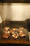 Cheeseburgers with bacon on the grill at Sympatico, Portland, Oregon