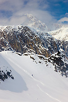 Backcountry skiing on the Ruth Glacier, Mt. McKinley enshrouded in clouds, view from the south side in the Alaska range, interior, Alaska.