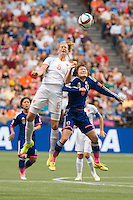June 23, 2015: Anouk DEKKER of Netherlands and Mizuho SAKAGUCHI of Japan jump for the ball during a round of 16 match between Japan and Netherlands at the FIFA Women's World Cup Canada 2015 at BC Place Stadium on 23 June 2015 in Vancouver, Canada. Japan won 2-1. Sydney Low/AsteriskImages.com