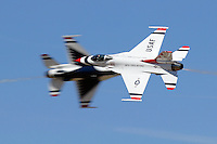 The United States Air Force Thunderbirds Lead and Opposing Solo aircraft (#5 and #6) perform a head on pass during a flight demonstration at the 2006 Reno National Championship Air Races at Stead Field in Nevada. The Thunderbirds were formed in 1956 and have been flying the F-16C Fighting Falcon since 1992. Photographed 09/06